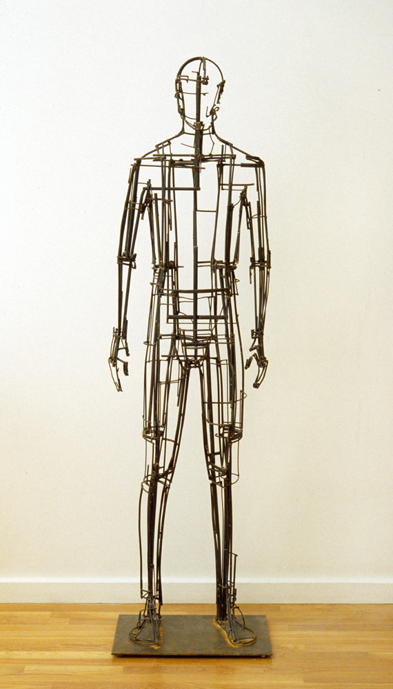 "Basis. 2005. Stainless steel and steel. accompanied by time lapse and hand held video. 72 x 20 x 13"". Darrin Hallowell"