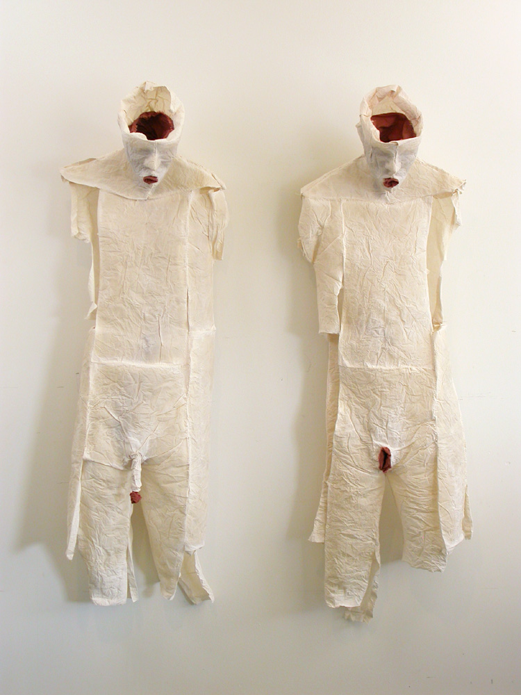 "His and Hers. 2007. Detail 1. Muslin, resin, thread, iron oxide. Each 39 x 17 x 12"" (dimensions variable). Darrin Hallowell"
