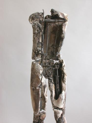 "Child II. 2003. Ceramic, stainless steel.  47 x 15 x 13"". First piece in a series of two. View detail back. Darrin Hallowell"