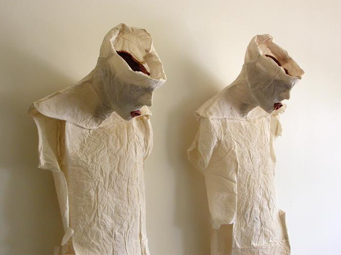 """His and Hers. 2007. Muslin, resin, thread and iron oxide. Each 39 x 17 x 12"""" Dimensions Variable. Detail 2. Darrin Hallowell"""