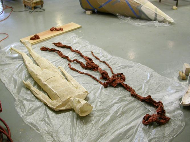 """Ariadne's Clew. 2007. Muslin, resin, thread, iron oxide, stainless steel. 108 x 73 x 108"""" (dimensions variable). Iron oxide soaked muslin ready to insert in completed figure. Darrin Hallowell"""