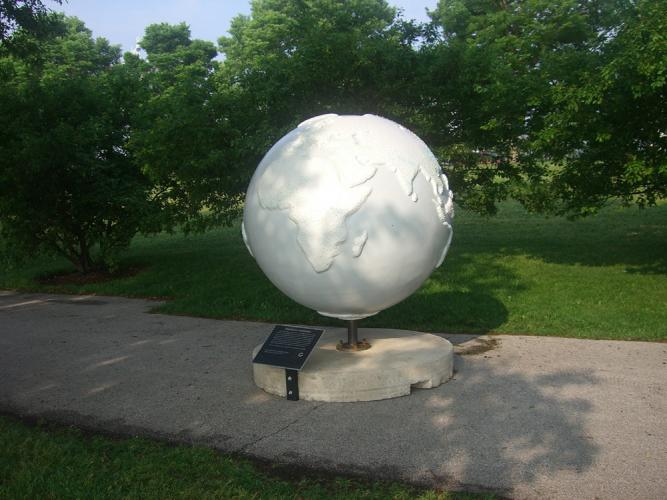 "Population Globe Proposal. 2007. Fiberglass and resin. 56x56x56"". View in Grant Park. Darrin Hallowell"