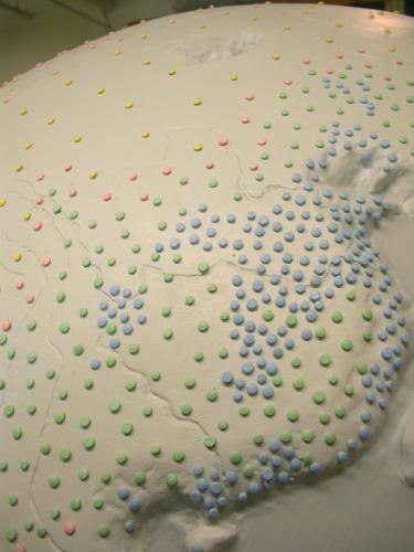 """Population Globe. 2007. Fiberglass and resin. 56x56x56"""". Detail 1. Darrin Hallowell"""