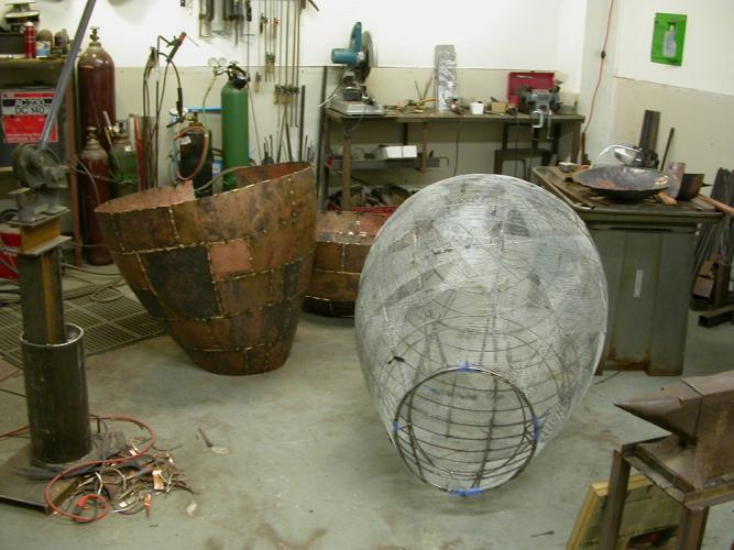 """Open Vessel. 2009. Bronze. 55 x 37 x 37"""". Forms are ready for assembly. Darrin Hallowell"""