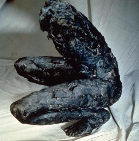 "Untitled (Crouching Figure). 1993. Aluminum. 40 x 24 x 28"". Side view. Darrin Hallowell"