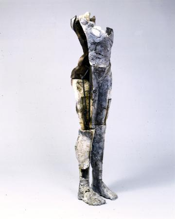 """Sustain Decay. 1999. Ceramic and stainless steel, 58 x 15 x 13"""". 3/4 view front. Darrin Hallowell"""