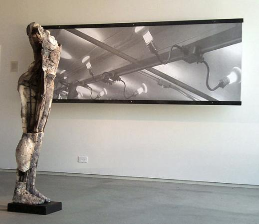 """Sustain Decay. 1999. Ceramic and stainless steel, 58 x 15 x 13"""". View at Men at Work Exhibition. Darrin Hallowell"""