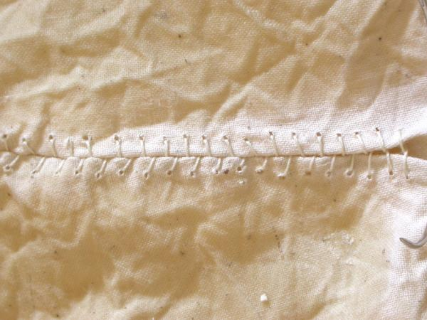 """Nourish. 2005. Linen, resin and thread. 20 x 12 x 6"""". Sewing detail 2. Darrin Hallowell"""