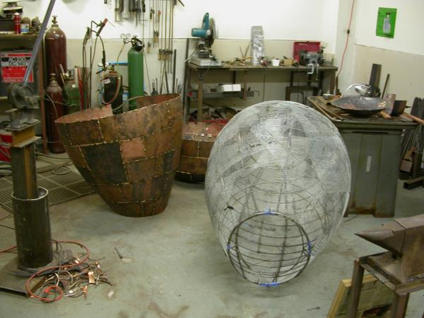 "Open Vessel. 2009. Bronze. 55 x 37 x 37"". Forms are ready for assembly. Darrin Hallowell"