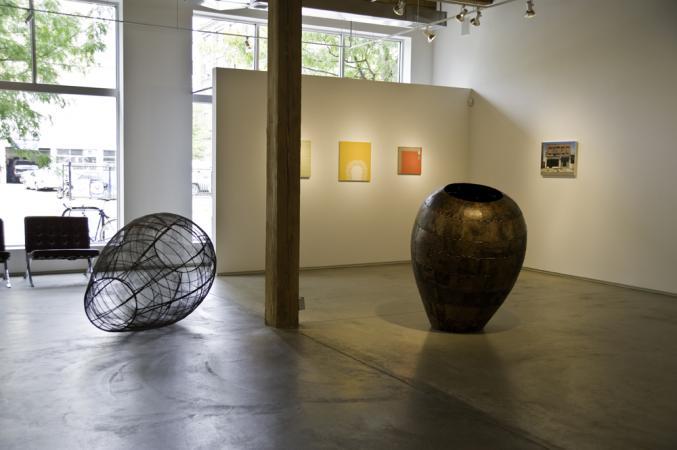 """Front gallery Dirty Dozen show McCormick gallery. Open Vessel. 2009. Bronze. 55 x 37 x 37"""". Open Vessel (Trace). 2009. Steel. 55 x 37 x 37"""". Darrin Hallowell"""