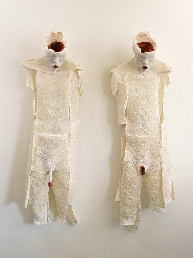 """His and Hers. 2007. Detail 1. Muslin, resin, thread, iron oxide. Each 39 x 17 x 12"""" (dimensions variable). Darrin Hallowell"""